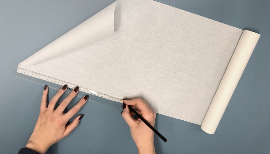 Het Toppits® boterhampapier wordt afgemeten met een meetlat